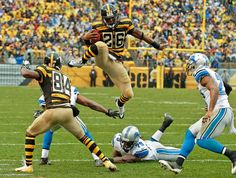 Pittsburgh Steelers running back Le'Veon Bell (26) leaps for more yardage as he tries to evade Detroit Lions strong safety Glover Quin