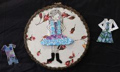 Paper Doll Hoop by Frances Fabric, cardboard, braid