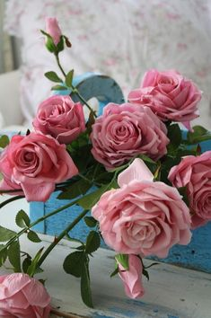 A profusion of pink roses in a beautiful blue box!