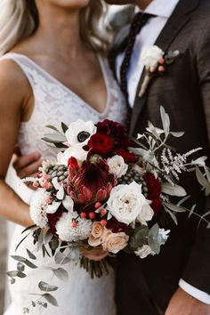How gorgeous is this winter wedding bouquet? We love red wedding bouquets in the winter. Check out our round-up of the best winter wedding flowers, including winter wedding button holes and winter wedding floral centrepieces! Winter Wedding Flowers, Fall Wedding Bouquets, Bride Bouquets, Bridal Flowers, Floral Wedding, Red Flowers, Red Roses, Red Flower Bouquet, Burgundy Wedding Flowers