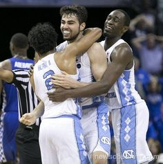 North Carolina's Joel Berry II (2) and Theo Pinson (1) embrace Luke Maye (32) after he hit the game winning shot with :03 reaming in the game to give North Carolina a 75-73 victory over Kentucky in the NCAA South Regional Final on Sunday, March 26, 2017 at FedExForum in Memphis, TN.