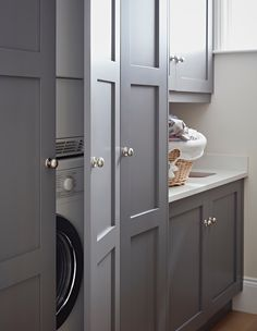 If you have the space, a utility room is a great place to store additional kitchen items, but the primary function is to tidy away laundry appliances and cleaning equipment. In this modern grey Original Shaker utility room by John Lewis of Hungerford, the laundry appliances are stacked and hidden in a tall cabinet, with room for brooms, mops and cleaning products in a matching cabinet. In this example, there is room for a small sink and worktop area, creating a fully functional working…