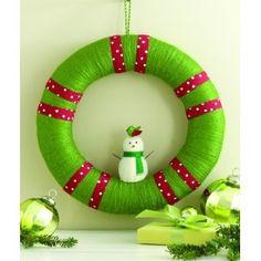 Foam wreath & Yarn. Hot glue a snowman on.