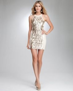 """Textured Sequin Cutout Dress - TAPIOCA/GOLD (XL)Exotic sequin design panels and strappy cutout detail make this bebe cocktail dress a real stand out. Features round neckline and heavy, stretchy bodycon drape. Pair it with chunky jewelry and bootie sandals to really maximize this look. Hidden back 11"""" zipper. Fully lined. Center back to hem: 22""""."""