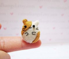 Hey, I found this really awesome Etsy listing at https://www.etsy.com/listing/179260773/felt-miniature-felted-miniature-hamster  This shop is just precious!! <3