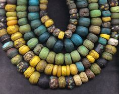 Coloured beads, look like old glass, but could be made from polymer