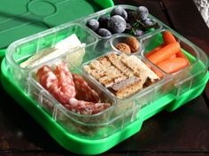 A new one-lid bento box that works with liquids and dry foods. You can pack apple sauce next to a sandwich and it won't leak! By Yumbox.