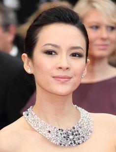 """""""People keep pushing me to be the center of attention... I would prefer to be on the sidelines, because that's where you see more."""" Gong Li"""