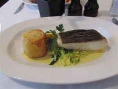 Pan Roasted Halibut with fondant potato and saffron creamed leeks at Waterloo Bar and Kitchen in Waterloo, London