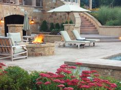 I like the stairs coming from the main level to the lower outdoor walkout basement and patio area. (Old World Fire Pit - 20 Backyard Fire Pit Design Ideas on HGTV.)