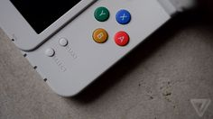 The New Nintendo 3DS loads a secret game when you tap out the Mario theme