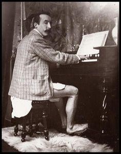 Paul Gauguin playing the harmonium in Alfons Mucha's studio, Rue de la Grande-Chaumière, Paris, c.1895