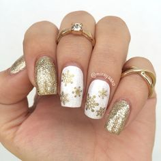 ✨The first of many Christmas/Winter nails❄️❄️❄️Colors: @chinaglazeofficial De-Light from the new #Twinkle collection, White on White and Fairy Dust on top. Gold snowflakes are from @winstonia_store Midi rings from @charlotterusse ✨