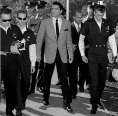 """On Thursday, September 6, Presley's scenes were scheduled to be shot in the fair's amusement park area, the Gayway.Although the Gayway was closed to the public during the shoot, many people paid admission to the fair that day in order see the star in action.""""Some adore him. Others can't stand him.But Elvis Presley drew hundreds of loyal fans and curiosity seekers to the World's Fair's Gayway today [to watch Presley] film the next scene of his motion picture amid the noise and"""