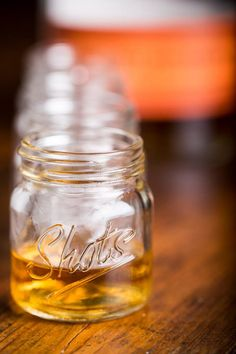 The Mason Jar Shot Glass holds 2.4 oz (we like really big shots).   BourbonandBoots.com #masonjar #shotglass
