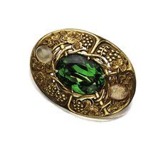 Peridot And Opal Brooch Mounted In Gold, Signed Tiffany & Co.,   c. 1910   -   Sotheby's