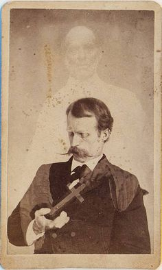 The spiritualist movement was deeply committed to a christian view of the afterlife.An extra stands behind a man and hands him a cross. Since the man looks down at the cross and subjects in spirit photographs most often seem unaware of the extras around them it seems likely that he is a medium with the ability to see the extras.