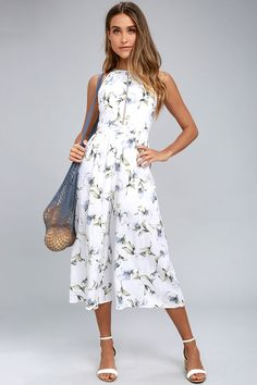 We cannot get enough of the cute and romantic vibes of the Lost + Wander Havana White Floral Print Midi Jumpsuit! Gauzy woven fabric, with a blue and green floral print, shapes a high, rounded neckline, fitted waist, and wide-cut culotte pant legs. Pintucked pleats and pierced embroidered accents. Hidden back zipper/clasp.
