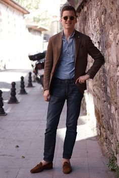 Shop this look for $241:  http://lookastic.com/men/looks/dark-brown-tassel-loafers-and-navy-jeans-and-blue-longsleeve-shirt-and-brown-blazer/2157  — Dark Brown Suede Tassel Loafers  — Navy Jeans  — Blue Longsleeve Shirt  — Brown Blazer