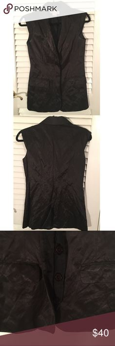 Michael Kors dressy black vest Michael Kors black vest. Looks really cute with leggings!! WORN but in great condition! Does button down (buttons are hidden). MICHAEL Michael Kors Tops Blouses