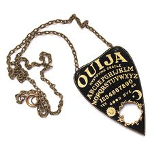 Black and gold acrylic laser cut and engraved Ouija Planchette design necklace, on bronze chain. Check photos for size comparison.