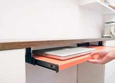 Genius! We love the way Kim & Scott took matters into their own hands and DIY-ed a computer tray to suit their needs and to add storage and workspace to their studio! #storage #organization