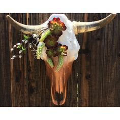 All of our cow skulls are authentic and each is unique in its own way. Once the skull is cleaned and bleached, it is then adorned with hand-picked embellishments and sometimes coated with clear varnish or paints. The items used to decorate the skulls are often one-of-a-kind, vintage or just freak...