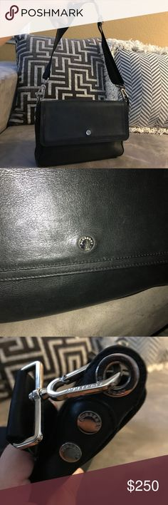 Authentic Burberry leather small bag Used but good condition. Black supple leather with shoulder starp that spells Burberry Burberry Bags Shoulder Bags