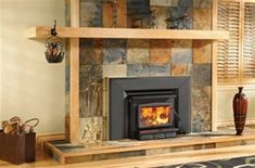 Many wood burning fireplace inserts can increase the efficiency of a traditional fireplace. It fits into the opening of the fireplace. Wood Stove Fireplace Insert, Small Gas Fireplace, Prefab Fireplace, Tiled Fireplace Wall, Wood Burning Fireplace Inserts, Outdoor Gas Fireplace, Outdoor Fireplace Designs, Paint Fireplace, Fireplace Mantels