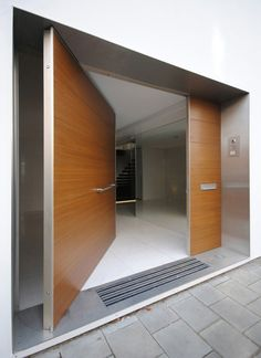 Large pivoting door inside Haus Bavaria by Carlo Berarducci Architecture.