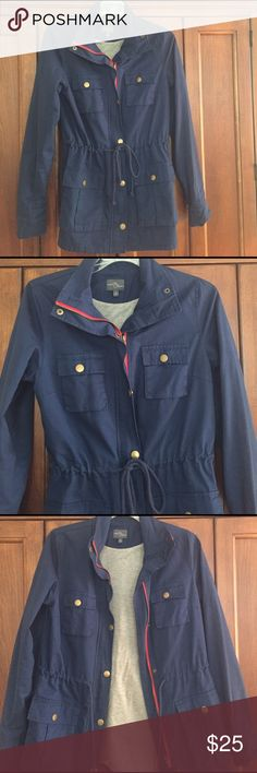 Spring Jacket Navy blue jacket with red zipper and button closures.  Light lining inside for extra warmth.  Four pockets with buttons on front with tie at waist.  Brand new condition. Jackets & Coats