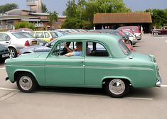 1960 Ford Anglia.  My Mom's first car gave us all great freedom!