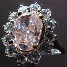 """A natural Fancy Orangey-Pink diamond, offered by Diamonds By Lauren on Ebay. The stone weighs 1.49 carats. """"I don't notice any orange- but the GIA color  origin report indicates as Fancy Orangey-Pink.  http://www.stores.ebay.com/id=10796839"""