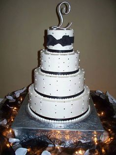 Fondant ribbon/bow is extra, but design is no extra charge. A Spoon Fulla Sugar, Wedding Cakes, Cincinnati