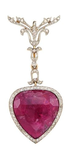 A Belle Epoque Platinum, Gold, Rubellite and Diamond Lapel Brooch, Circa 1905.