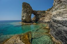 11. Bathe in the crystal-clear water of the Ionian sea off the Greek island of Paxi.