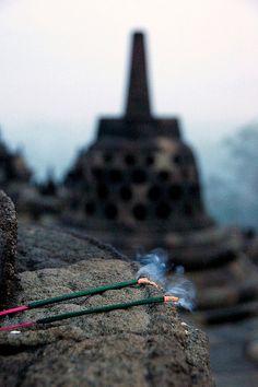 Incense sticks on a stupa by Shreyans Bhansali, via Flickr - Borobudur, Near Yogyakarta, Indonesia 29 June 2008.