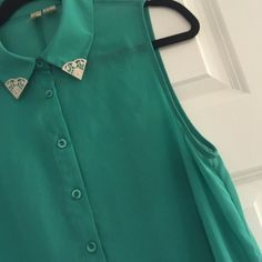 Forever 21 high low teal top Forever 21 high low button up top. Sheer material. With silver detailing on collar. Great conduction. Forever 21 Tops