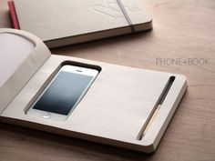 A Notebook With A Cut-Out Space For Phones