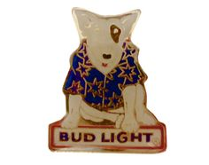 """Spuds MacKenzie BUD LIGHT BEER vintage enamel pin lapel badge by VintageTrafficUSA  14.00 USD  A vintage BUD LIGHT pin. Excellent condition. Measures: approx 1"""" 30 years old hard to find vintage high-quality cloisonne lapel/pin. Beautiful die struck metal pin with colored glass enamel filling. -------------------------------------------- SECOND ITEM SHIPS FREE IN USA!!! LOW SHIPPING OUTSIDE USA!! VISIT MY STORE FOR MORE ITEMS!!! http://ift.tt/1PTGYrG FOLLOW ME ON FACEBOOK FOR SALE CODES AND…"""