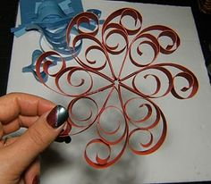 Paper swirly Christmas Ornaments. Make overly large in the shape of a Mickey head for DIY wall decoration :D