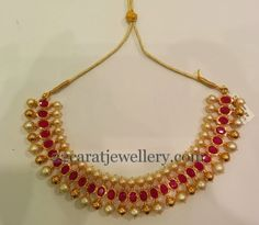 Large round ruby stones studded 22 carat gold necklace with gold soft balls and south sea pearls hanging in the bottom. Pretty this prett. Gold Earrings Designs, Gold Jewellery Design, Necklace Designs, Gold Jewelry, Jewelery, India Jewelry, Temple Jewellery, Indian Wedding Jewelry, Bridal Jewelry