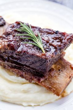 Classic Braised Beef Short Ribs are cooked low and slow until they reach fall-off-the-bone deliciousness.  This simple dish is a classic that is full of comfort food flavor.