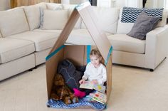 Make a collapsible playhouse with a cardboard box.