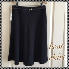 """Covington Essentials Boot Skirt Black A-line boot skirt. Side zip, belt loop, belt included. 76% polyester, 20% rayon, 4% spandex.  27"""" long from center front. Covington Skirts"""