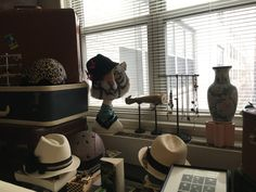 Creative fedora hats, bicycle helmets, suitcases, and flower vase available for short term and long term prop rentals - for photo shoots, movies and television, or for painters and photographers.  Manhattan pickup.