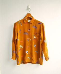 Vintage Burnt Sienna Fancy Assortment  Printed Long Sleeves Silky Top DEADSTOCK. $28.00, via Etsy.