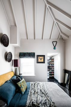 Taking a trip upstairs, a low-ceiling in the master bedroom was removed which allowed them to build a spare bedroom on a mezzanine level in the extra space Guest Bedroom Office, Home, Space Saving, Low Ceiling, Living Room Pendant, Low Ceiling Bedroom, House, Corner House, Maximalist Interior
