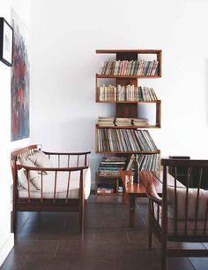 Nougat wood---never considered doing wood like this in my living room, but this space almost made me change my mind. love that book case.
