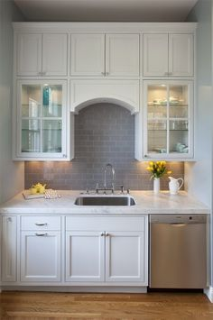 Gray Subway Tile Kitchen - Design photos, ideas and inspiration. Amazing gallery of interior design and decorating ideas of Gray Subway Tile Kitchen in bathrooms, kitchens by elite interior designers. Gray Subway Tile Backsplash, Grey Subway Tiles, Subway Tile Kitchen, Grey Kitchen Cabinets, Herringbone Backsplash, White Cabinets, Backsplash Design, Glass Cabinets, Kitchen Backsplash